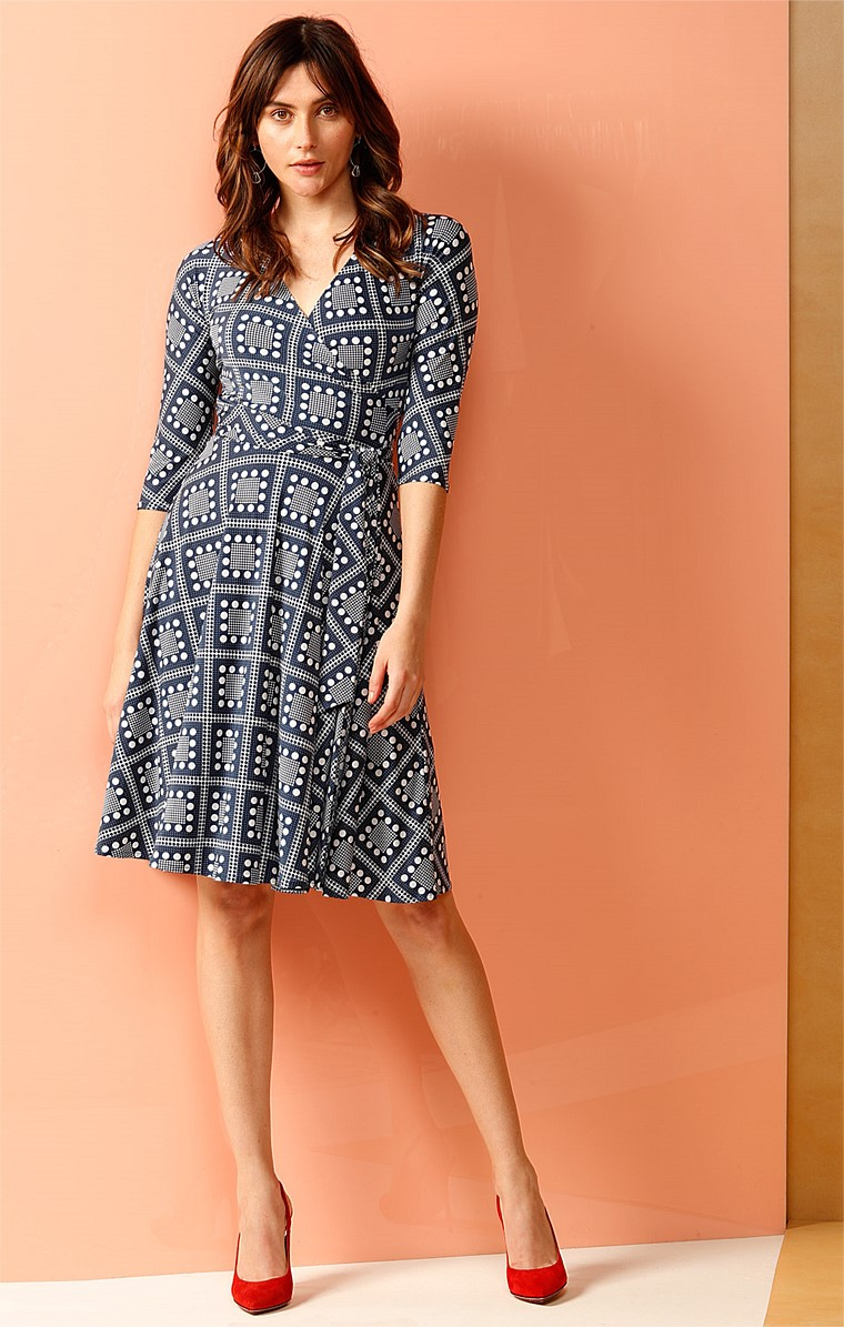 CAROUSEL REVERSE WRAP 3/4 SLEEVE FULL SKIRT KNEE LENGTH JERSEY DRESS IN NAVY IVORY PRINTS