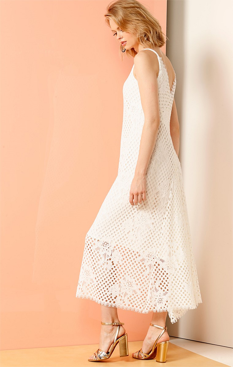 VISTA POINT HI-LO HEM V-BACK LACE DRESS IN WHITE CORDED STRETCH LACE
