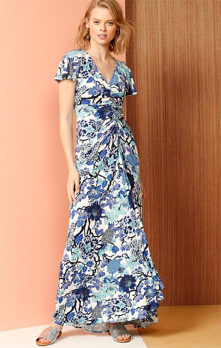 BLUE DUCHESS STRETCH JERSEY GATHERED FRONT MAXI DRESS IN BLUE FLORAL PRINT