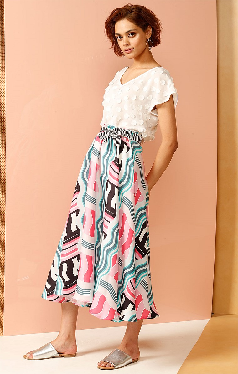 WOLLMAN RINK A-LINE CUPRO MIDI SKIRT IN JADE AND PINK WAVE PRINT
