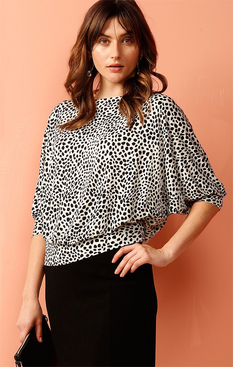 LOEB LOOSE FIT BATWING STRETCH JERSEY TOP IN BLACK AND WHITE ANIMAL SPOT