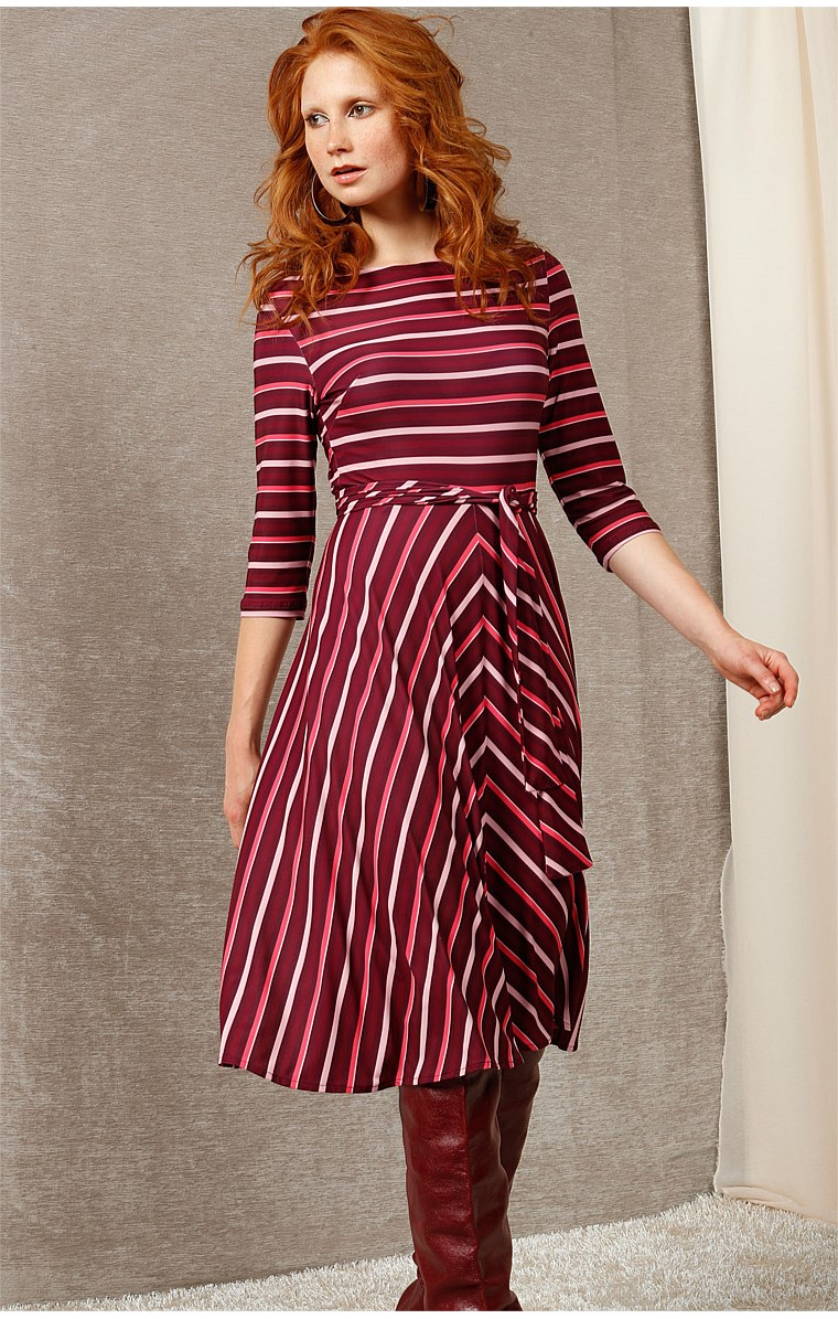 CLARE STRETCH JERSEY 3/4 SLEEVE A-LINE DRESS IN PLUM PINK STRIPE