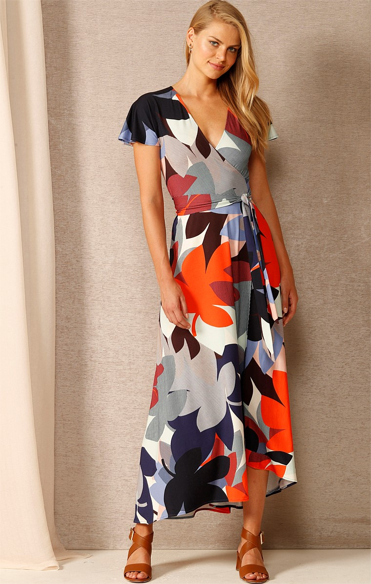 GLORY DAYS STRETCH JERSEY V-NECK WRAP DRESS IN COBALT TANGERINE FLOWER PRINT
