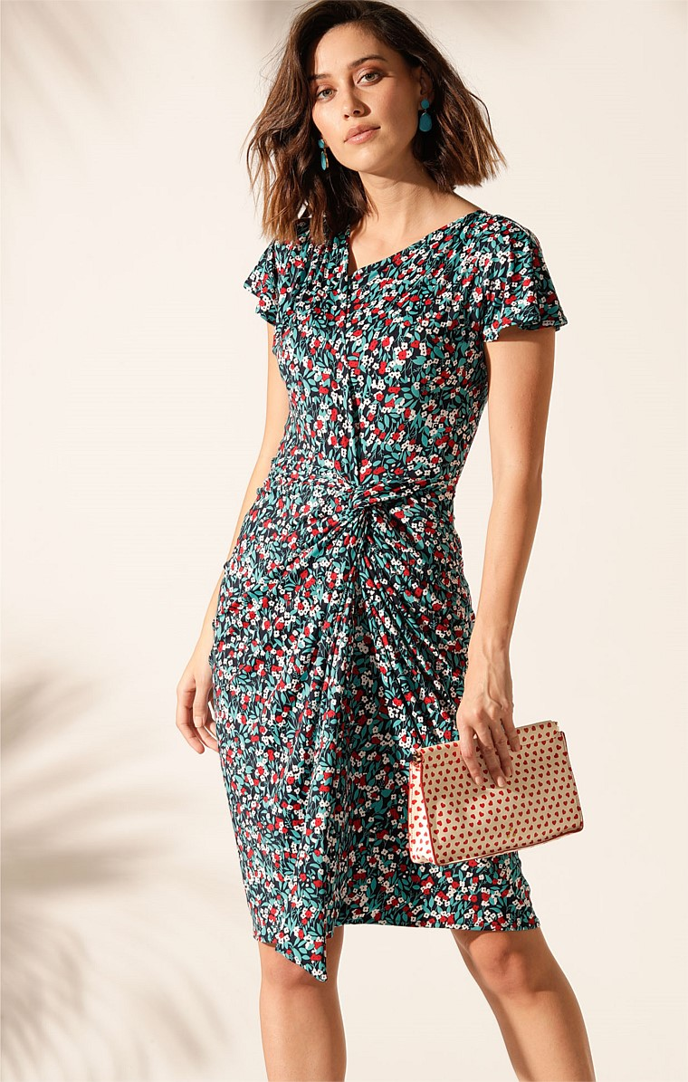 SOUTH CAROLINA STRETCH JERSEY KNOT WAIST CAP SLEEVE KNEE-LENGTH DRESS IN TURQUOISE MINI FLORAL PRINT