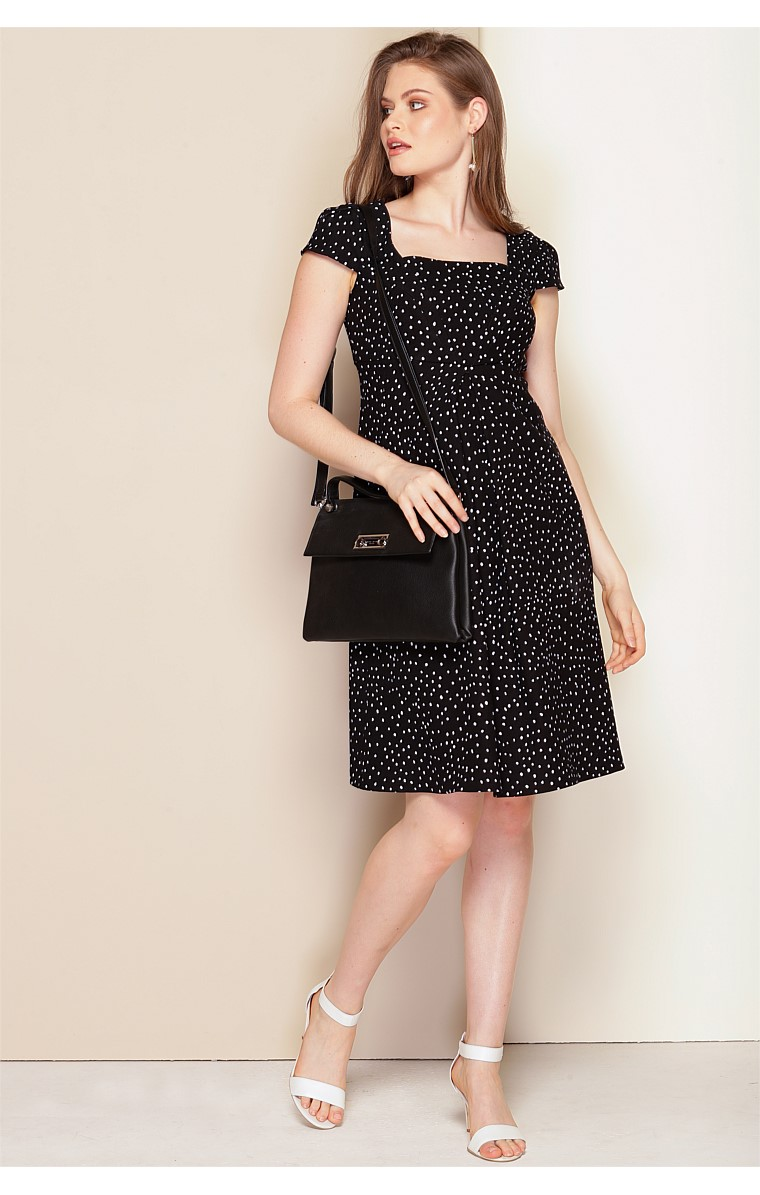MILOT STRETCH CAP SLEEVE FIT AND FLARE SHIFT A-LINE DRESS IN BLACK WHITE SPOT