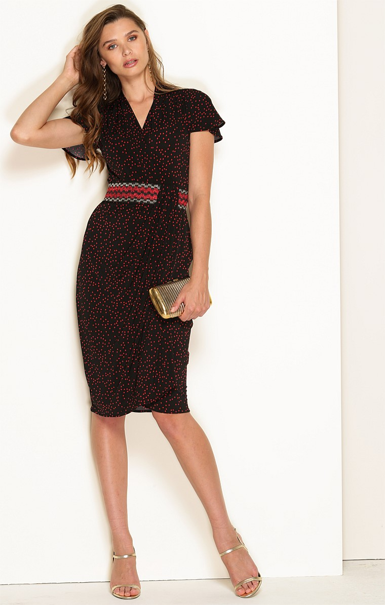 HILDAGO FITTED STRETCH JERSEY FLUTED CAP SLEEVE V-NECK KNEE LENGTH DRESS IN BLACK RED SPOT