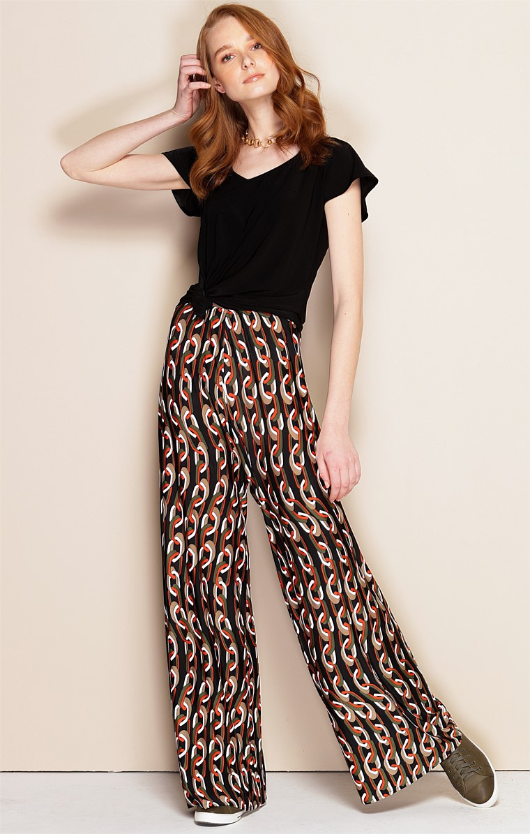 SEAMLESS STRETCH JERSEY WIDE LEG PANT IN KHAKI RUST LINK PRINT