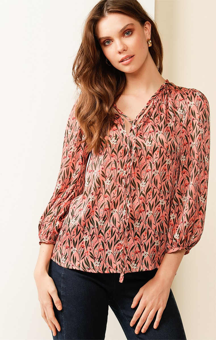HEATHER 3/4 SLEEVE LOOSE FIT HIGH-NECK TIE TOP BLOUSE IN PINK FOLK FLORAL PRINT