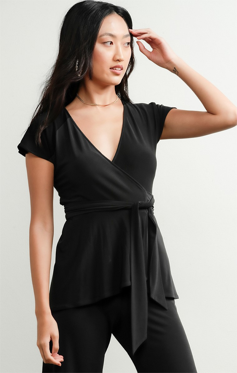 CAP SLEEVE STRETCH JERSEY V-NECK WRAP TOP IN BLACK