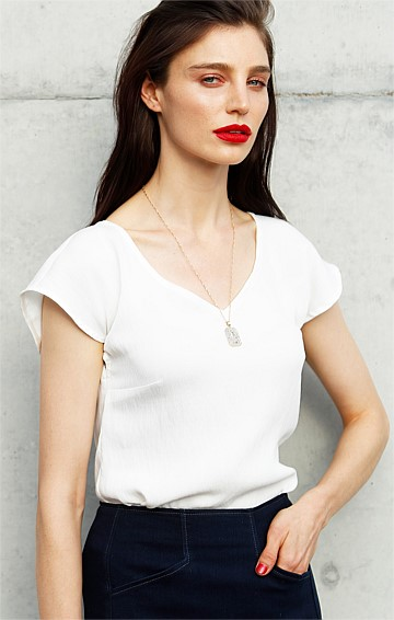 ANALIA LOOSE FIT V-NECK CAP SLEEVE BLOUSE TOP IN IVORY