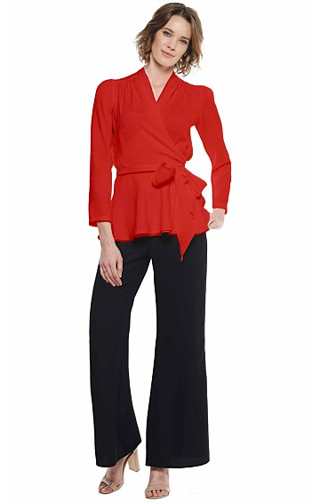 HAYWORTH LONG SLEEVE PEPLUM A-LINE WRAP TOP IN RED JACQUARD