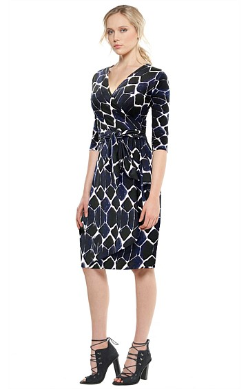 DARK IRIS 1927 FAUX WRAP STRETCH JERSEY V-NECK DRESS IN NAVY BLACK DIAMOND PRINT