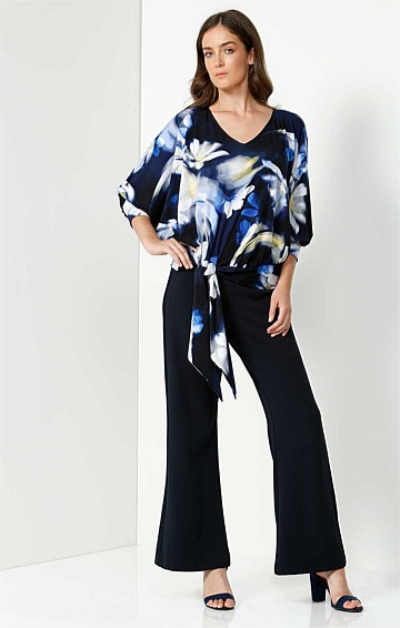 HEDI LOOSE FIT BATWING STRETCH JERSEY ADJUSTABLE TIE TOP IN BLUE YELLOW FLOWER PRINT