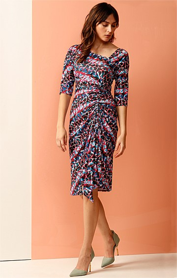 HECKSCHER ASYMETRIC GATHERED STRETCH 3/4 SLEEVE JERSEY DRESS IN MULTI FRAGMENT PRINT