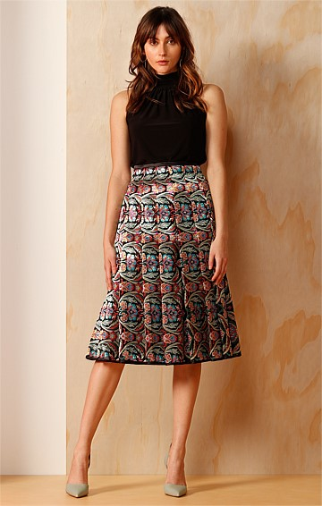 SARACENIC WOVEN CHINOISERIE JACQUARD PLEATED KNEE LENGTH SKIRT IN MULTI PRINT