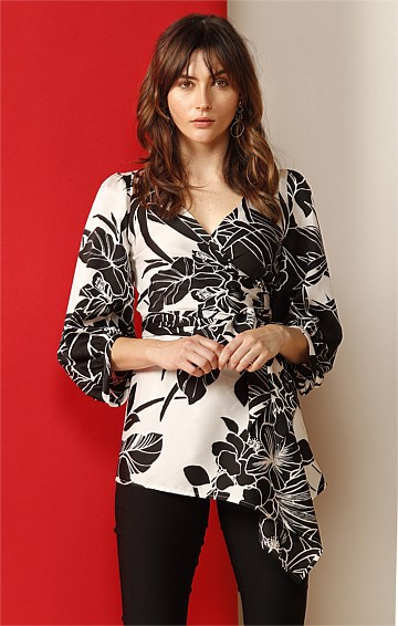 OBSERVATORY BISHOP SLEEVE ASYMMETRIC HEMLINE WRAP TOP IN BLACK IVORY FLOWER PRINT
