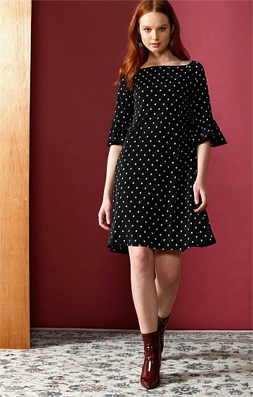 NESBITT FLUTE SLEEVE STRETCH KNEE LENGTH TUNIC JERSEY DRESS IN BLACK WHITE SMALL POLKADOT PRINT