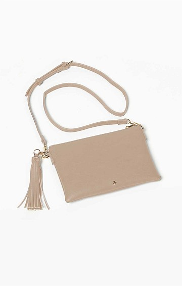ZIP TOP CONVERTIBLE CROSS BODY CLUTCH BAG WITH TASSEL IN NUDE