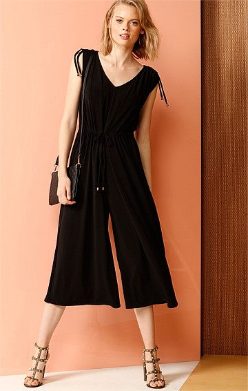 COLUMBUS CIRCLE STRETCH JERSEY WIDE LEG ADJUSTABLE JUMPSUIT IN BLACK