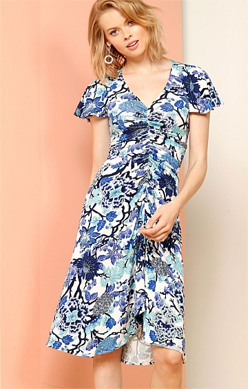 BLUE DUCHESS STRETCH JERSEY GATHERED FRONT MIDI DRESS IN BLUE FLORAL PRINT