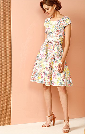 WAIPOUA COTTON JACQUARD DROP WAIST GATHERED SLEEVE FRILL HEM DRESS IN LEMON FLORAL PRINT