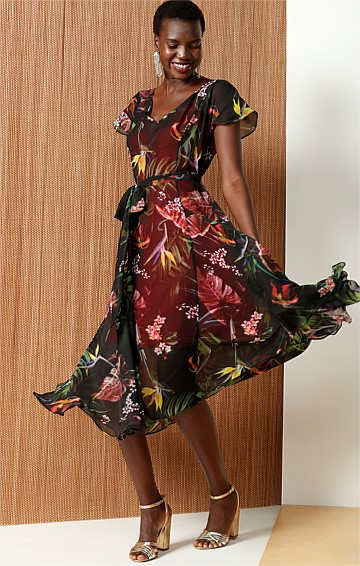 PARADISE FLUTE SLEEVE DROP WAIST A-LINE DRESS IN BLACK FLOWER