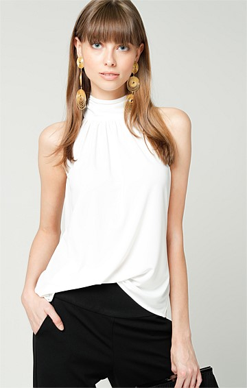 HIGH NECK SLEEVELESS STRETCHY JERSEY PEPLUM TIE TOP IN IVORY