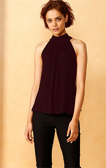 HIGH NECK SLEEVELESS STRETCHY JERSEY PEPLUM TIE TOP IN BLACK CHERRY