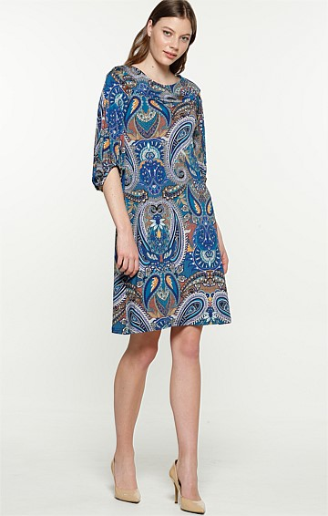 JUDITH 3/4 BISHOP SLEEVE BOAT-NECK TUNIC DRESS IN BLUE GOLD PAISLEY PRINT