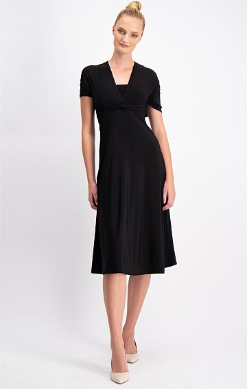 THE ULTIMATE CONVERTIBLE STRETCH JERSEY DRESS IN BLACK