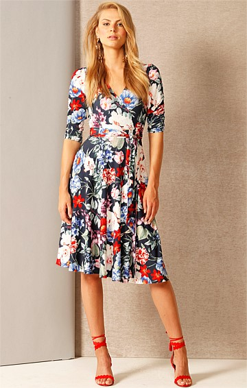 MAY REVERSE WRAP 3/4 SLEEVE KNEE-LENGTH JERSEY DRESS IN NAVY FLORAL PRINT