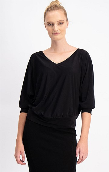 BERTIE LOOSE FIT STRETCH JERSEY BATWING SLEEVE TOP IN BLACK