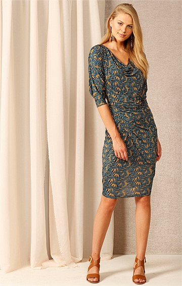 NOW OR NEVER STRETCH JERSEY V-NECK KNEE-LENGTH TIE DRESS IN TEAL MUSTARD PRINT