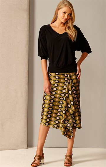SECOND WIND PULL ON A-LINE KNEE-LENGTH SKIRT IN OLIVE BLACK ABSTRACT PRINT