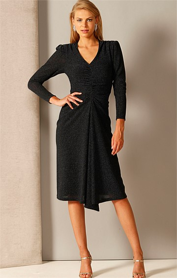 TRIUMPH STRETCH LONG SLEEVE V-NECK GATHERED WAIST MIDI DRESS IN MIDNIGHT LUREX