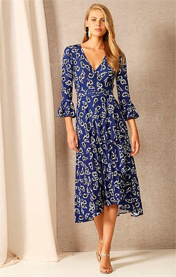 DON'T WORRY BE HAPPY STRETCH JERSEY V-NECK A-LINE MIDI WRAP DRESS IN INDIGO FLORAL ABSTRACT PRINT