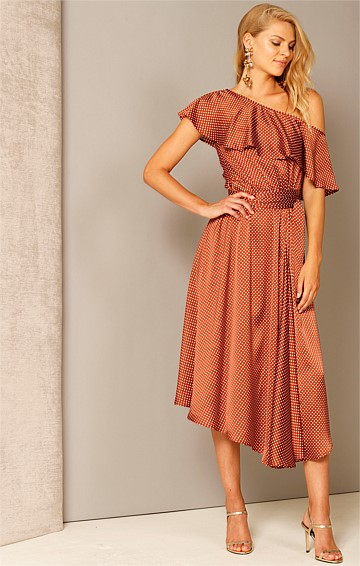 SWEET BIRD OF YOUTH ONE SHOULDER ASYMMETRICAL A-LINE DRESS WITH CAPE IN RUST IVORY SPOT PRINT