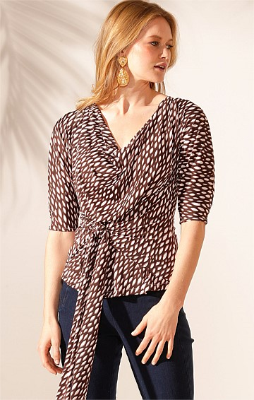 THE ONLY WAY IS UP JERSEY REVERSIBLE 3/4 SLEEVE COWL NECK TIE TOP IN CHOC WHITE LEAF PRINT