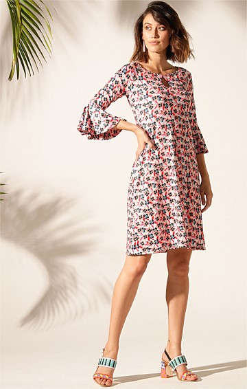 LITTLE HILLS BELL SLEEVE KEYHOLE NECK KNEE LENGTH STRETCH JERSEY PRINTED TUNIC DRESS IN PEACH PANSY