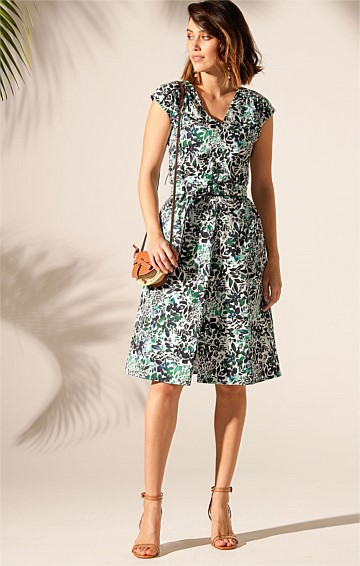 DESSALINES COTTON V-NECK CAP SLEEVE KNEE-LENGTH DRESS IN BLUE GREEN FLORAL PRINT