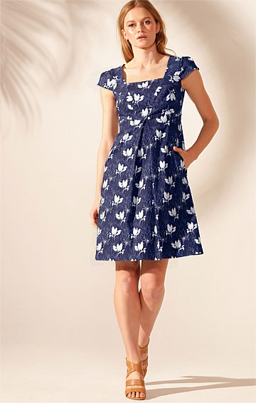MILOT NORDE STRETCH BENGALINE CAP SLEEVE FIT AND FLARE SHIFT A-LINE DRESS IN NAVY WHITE FLOWER PRINT