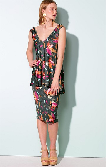 SANTO DOMINGO STRETCH JERSEY FITTED PEPLUM OVERLAY KNEE LENGTH DRESS IN OLIVE BIRD OF PARADISE PRINT