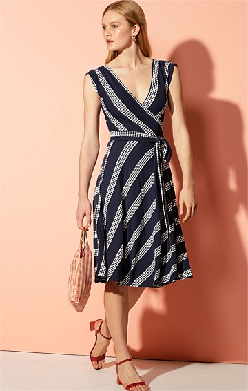 CITADELLE STRETCH JERSEY CAP SLEEVE V-NECK KNEE-LENGTH WRAP DRESS IN NAVY WHITE SPOT