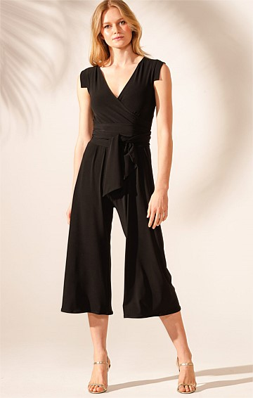 NIGHT FEVER STRETCH JERSEY V-NECK CAP SLEEVE WIDE LEG JUMPSUIT IN BLACK