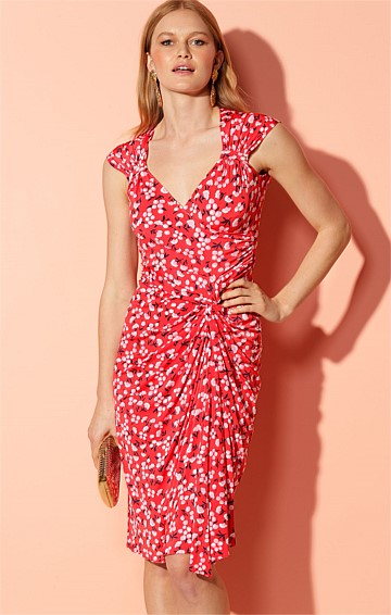 VASTEY STRETCH JERSEY FITTED CAP SLEEVE KNOT WAIST KNEE-LENGTH DRESS IN RED MINI FLORAL PRINT