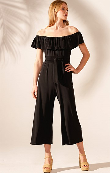 BLACK IRIS III OFF THE SHOULDER STRETCH JERSEY WIDE LEG JUMPSUIT IN BLACK