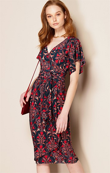 CHERUBINI STRETCH JERSEY FLUTED CAP SLEEVE V-NECK KNEE LENGTH DRESS IN ART DECO PRINT