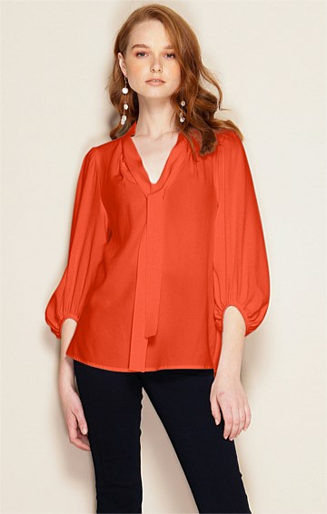 MIMI LOOSE FIT BISHOP SLEEVE FRONT NECK TIE BLOUSE IN TANGERINE