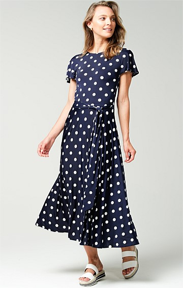REVERSE WRAP STRETCH JERSEY FLUTED SLEEVE V-NECK MIDI DRESS IN NAVY WHITE SPOT PRINT