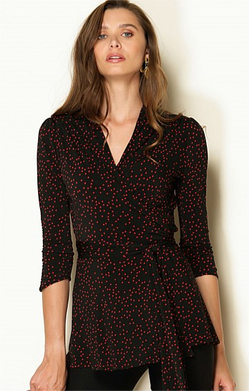 RIGOLETTO 3/4 SLEEVE STRETCH V-NECK WRAP TUNIC IN BLACK RED SPOT PRINT